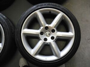 NISSAN MAXIMA OEM RIMS AND TIRES 18INCH 350$