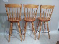 Three solid wood bar stools