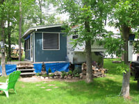27 fT FIFTH WHEEL WITH SCREANED IN PORCH AND DECK IN DUTRISAC