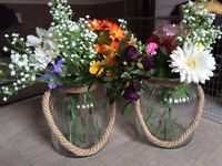 Artificial flowers and glass vases