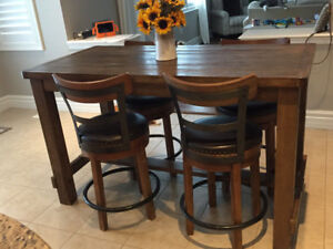 Counter height harvest table with 4 swivel stools