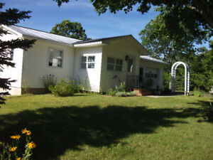 An Ideal Home on the Banks of the Miramichi  -  NEW PRICE