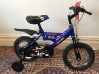 Child's clean Raleigh Micro bike (bicycle) with detachable stabilisers