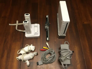 Nintendo Wii Console/2 sets of remotes/charger/all accessories
