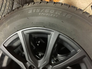 P215/60R16 Michelin winter tire package with aluminum rims Kitchener / Waterloo Kitchener Area image 3