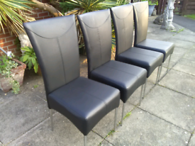 4 black faux leather dining chairs