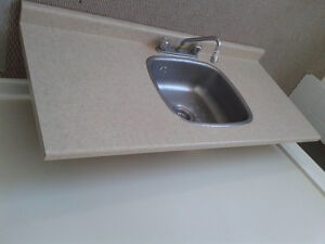 "54"" Countertop with Moen faucet and sink - $100"