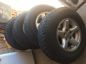 Stock rims from 2005 jeep tj sport and winter tires. 235s