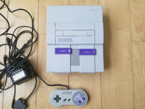Super nintendo with controller and hookups