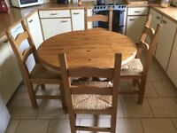 Solid farmhouse pine table and chairs which can be extended if need be