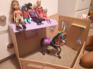 Lots of Barbie horses, riding barbies and stable