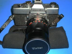 Minolta SRT-101 Camera  with 135 mm 2.8 Vivitar lens & Cases