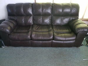 Leather couch. Pull out style.  Dark brown.