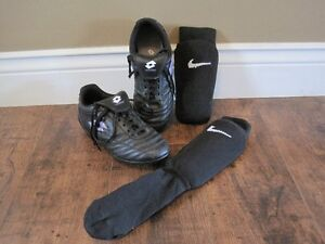 In good condition! Soccer cleats size 2 and shin pads