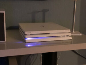1TB White PlayStation 4 Pro w/ 700+ games, second controller