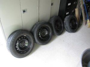 15 INCH VOLVO FACTORY RIMS WITH NEW SNOW TIRES
