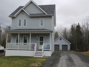 New price! Charming house with large garage