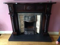 Fireplace, cast iron surround and tiles. Mirror to match