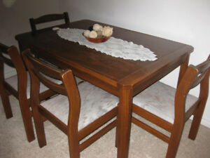 dining table w/ 4 chairs with matching hutch and dresser.