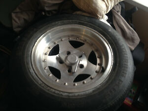 Two sets of 215/65R15 rims and tires