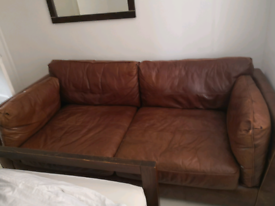 Large brown leather settee