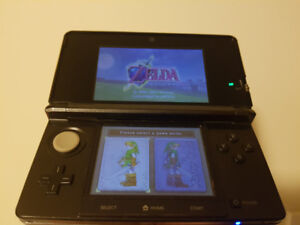 Nintendo 3DS with game, pen, and charger