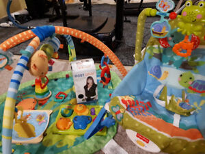 Unused baby carrier, barely used playpad, swing chair, baby toys