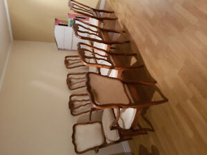 8 dining chairs in ok condition. 2 wing chairs. 6 regular