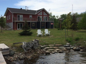 BEAUTIFUL HOME/COTTAGE ON SLOPING 157 FOOT WATERFRONT LOT!