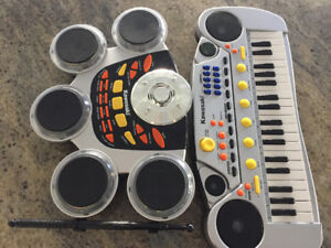 Kawasaki Electirc keyboard and drum set $25.00