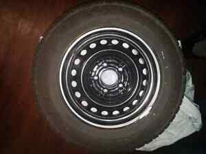 "Goodyear Nordic Winter 195/65R15 like new 15"" on rims"