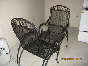 two solid wrought iron garden chairs