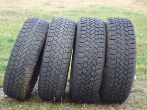 For Sale 4 winter studded tires with lots of tread 185-70-14