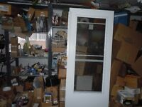 White colonial storm door