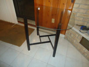 **ROUND TABLE WITH GLASS TOP**