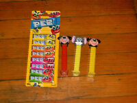 Three Pez Dispensers and Pack of Candy