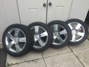 4 Toyo Versado LXII 235/50r18 97V tires on rims with TPMS.