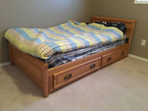 Two Natural Wood Finished Single Beds