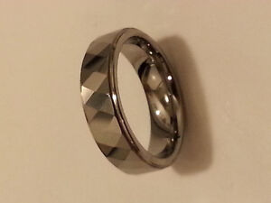 Brand new tungsten, multi faceted wedding band. 6mm.