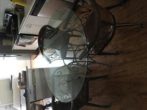 Excellent condition glass table and chairs