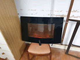 55. Wall mounted fire and remote