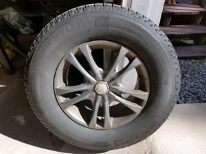 4 Michelin latitude x ice winter tires on rims