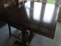 Marks and Spencer Dark Oak Table and four antique dining chairs