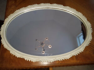 Beautiful vintage oval mirror in ornate (plastic but looks like
