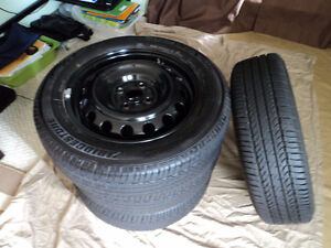 Bridgestone all season tires, rims for Yaris Accent Echo Corolla