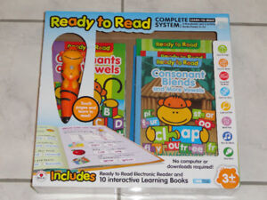 READY TO READ- COMPLETE SYSTEM- ELECTRONIC READER & 10 BOOKS