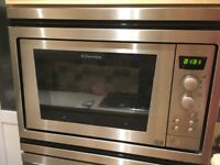 Electrolux Built in electric oven, microwave and 4 burner gas hob