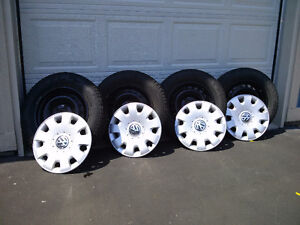 4 Pirelli Winter Tires on Steel Rims & 4 VW Jetta Wheel Covers.