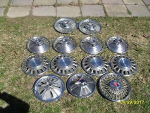 various classic mustang wheel covers.various prices.