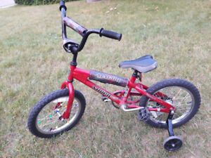 Child's bike with training  wheels for sale.